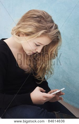 Teenager Wtih Mobile Taking A Selfie Or Writing An Sms
