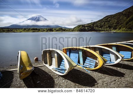 A row of boats sit in front of Mt Fuji in Japan