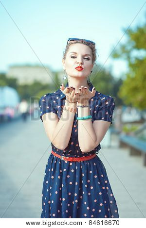 Beautiful Young Hipster Woman In Fifties Style Sending Kiss