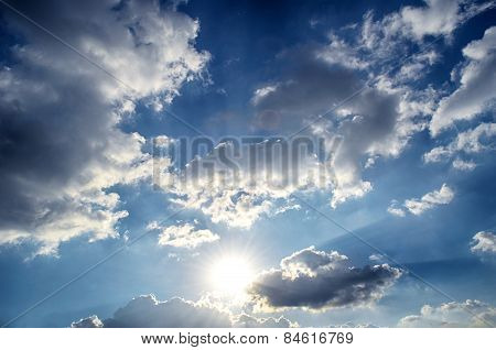 Blue sky with white cloud and sun