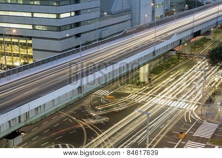 traffic light trails speed through a city