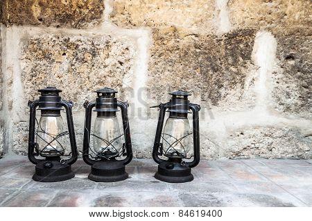 Three old lanterns in Santa Catalina monastery