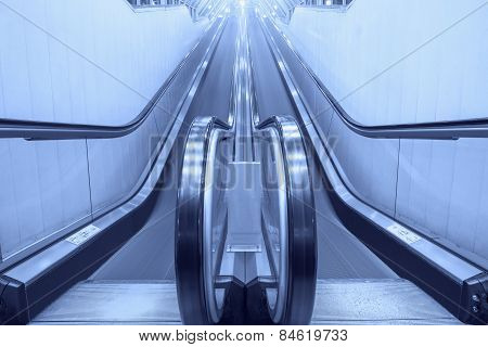 Empty moving escalator stairs.