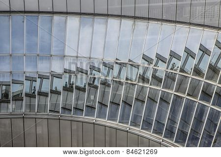 The reflection of a building in an abstract wall