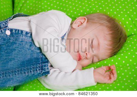 Little baby sleeping on a cushion
