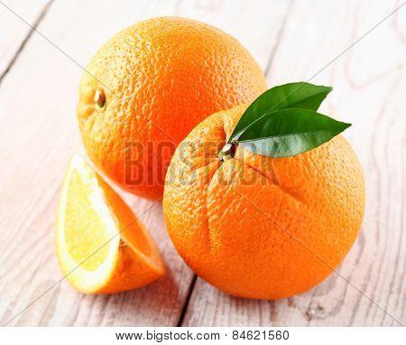 Fresh orange fruit on a wooden background