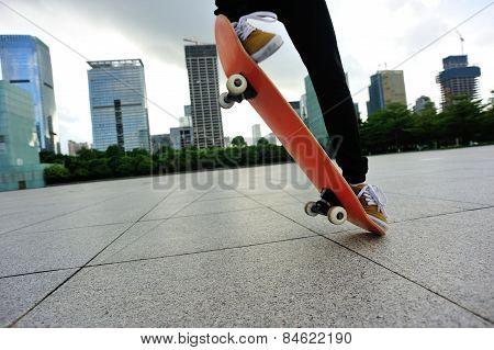 skateboarder legs skateboarding trick ollie at city skate park