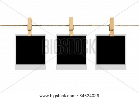 Blank Photo Frame On Cloth Line Isolated White Background