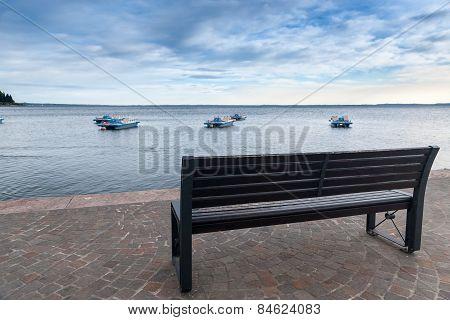 Wood Bench At The Garda Lake