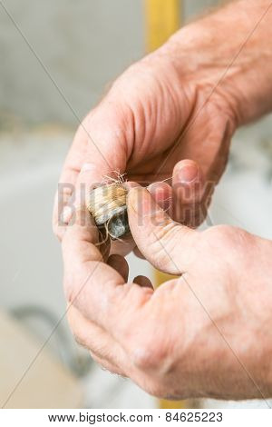 Plumber Hand With Seal Laging