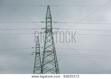 Power Poles And Lines Against Sky