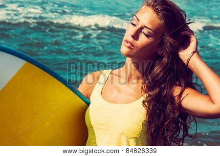 young woman portrait hold surfboard on seaside beach, sunny summer day