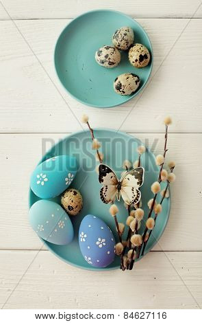 blue easter eggs on white wooden table