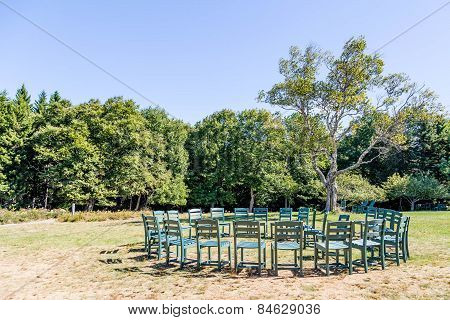 Circle Of Chairs In A Park