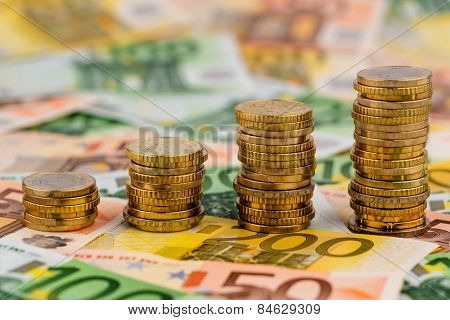 stack of money coins rising curve, symbolic photo for increasing profits and rising costs