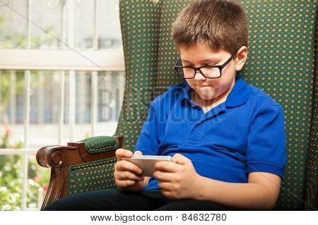 Little Boy Using A Smartphone