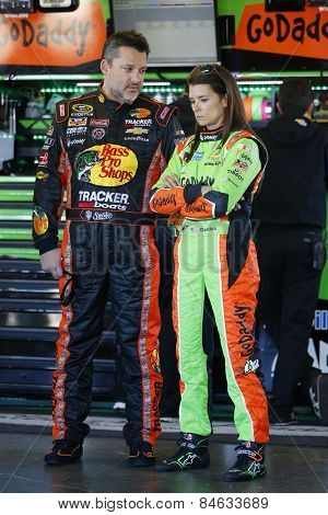 Daytona Beach, FL - Feb 18, 2015:  Tony Stewart (14) and Danica Patrick (10) talk during a practice session for the Daytona 500 at Daytona International Speedway in Daytona Beach, FL.