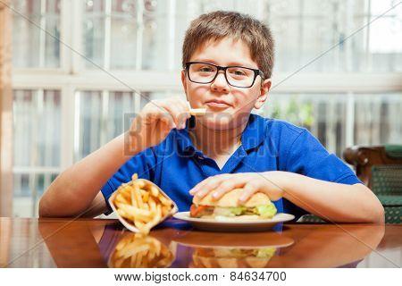 Cute Boy Eating Fast Food