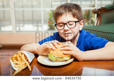 Kid Eating A Hamburger