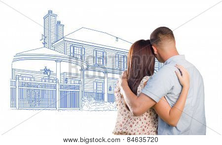 Embracing Military Couple Looking At House Drawing on White.