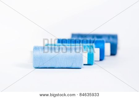 Threads Of Blue Shades On A White Background