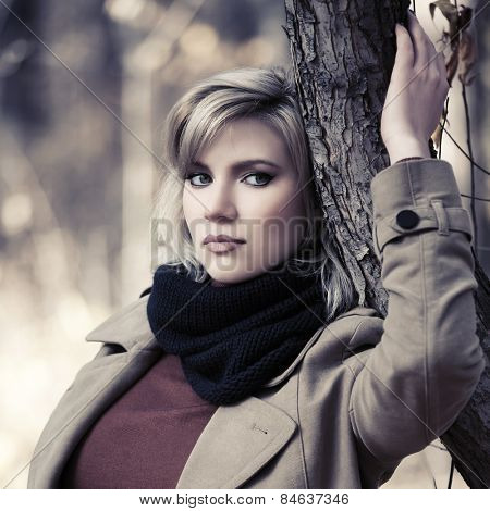 Sad beautiful fashion woman in autumn forest