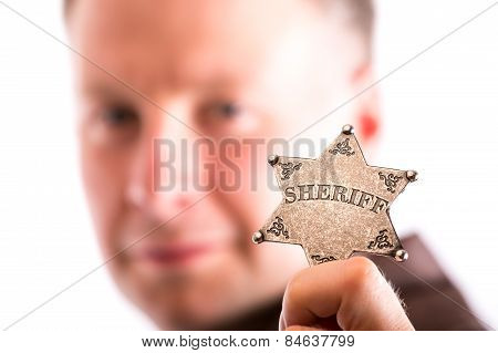 Man Holds Sheriff Badge