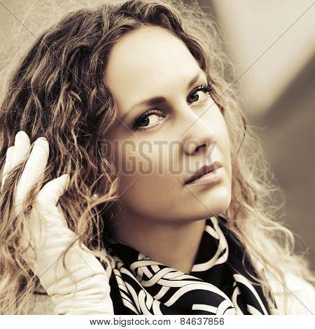 Sad beautiful fashion woman with long curly hairs