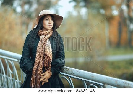 Girl In Hat Standing On The Bridge