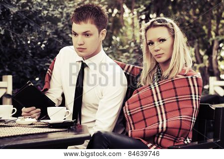 Young couple at a sidewalk cafe