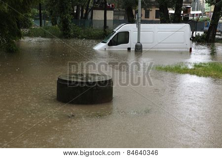 PRAGUE, CZECH REPUBLIC - JUNE 3, 2013: Minivan vehicle flooded by the swollen Vltava River in Prague, Czech Republic.