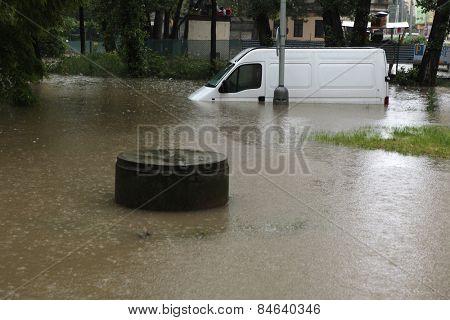 PRAGUE, CZECH REPUBLIC - JUNE 3, 2013: Minivan vehicle flooded by the swollen Vltava River in Prague, Czech Republic.