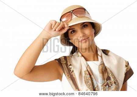 Closeup portrait of attractive young woman at summertime in hat.