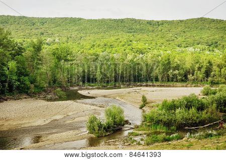 Stock Photo.  Mountain River In The Wood