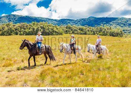 MINAS GERAIS, BRAZIL - CIRCA AUG 2014: People riding horses in a beautiful scenery