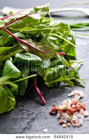 Rucola leaves on plate close-up