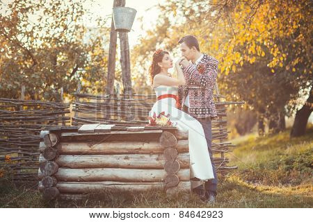 Newlyweds Near The Wooden Well