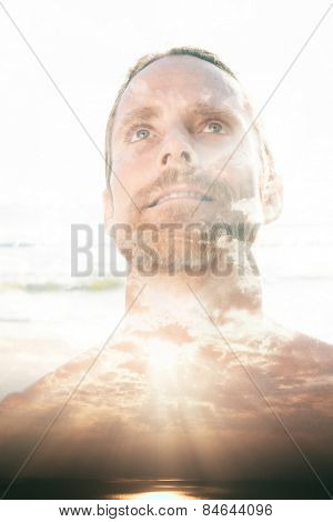 Double exposure portrait of a man combined with photograph of sunset