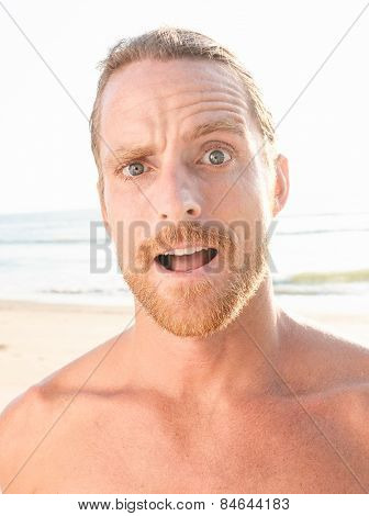 Close up Surprised Bare Handsome Goatee Man with Blond Hair Looking at the Camera Open Mouth.