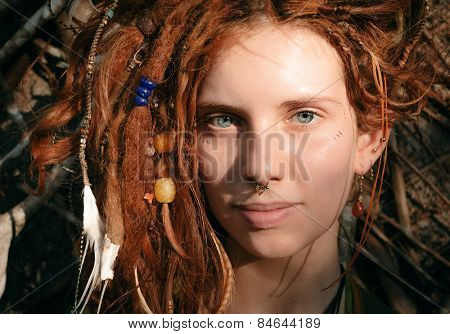 Close up Pretty Young Woman Face with Dreadlocks and Piercing Looking at the Camera.