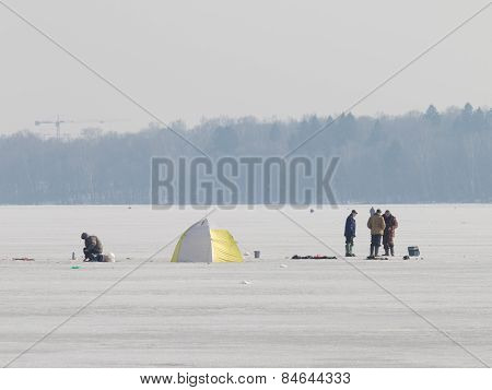 Fishermen Catch Fish On Ice