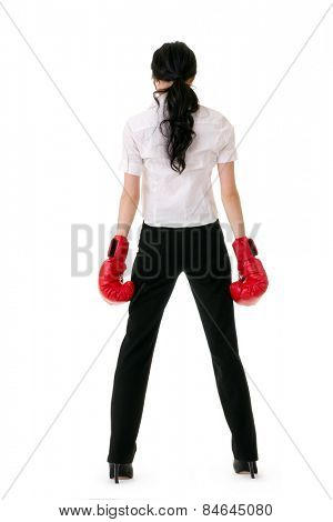 Business woman with red boxing gloves, rear view full length portrait on white background.