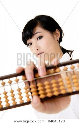 Chinese business woman holding traditional abacus on white background.