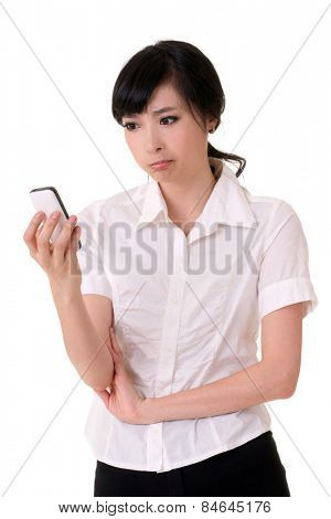 Worried business woman holding cellphone and looking, closeup portrait of Asian businessperson on white background.