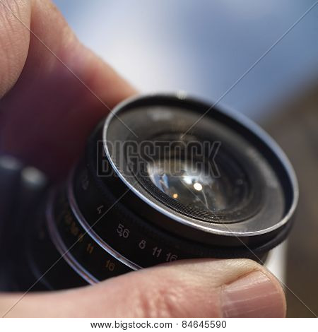 Hand On Lens