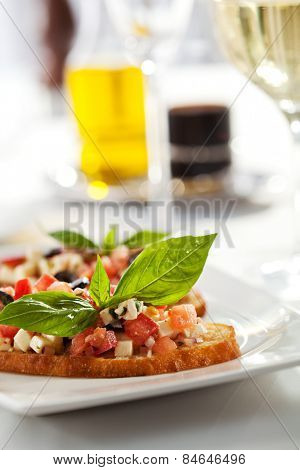 Italian Appetizer Bruschetta with Tomatoes, Cheese and Basil