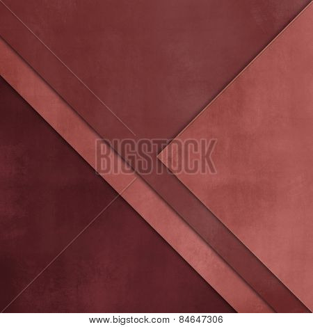 Layered paper background with soft texture in shades of red marsala