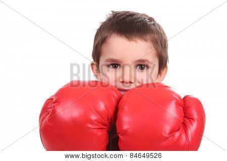 Portrait of a cute sporty boy in boxing gloves