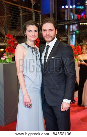BERLIN, GERMANY - FEBRUARY 14: Daniel Bruehl and his girlfriend Felicitas Rombold attend the Closing Ceremony of the 65th Berlinale International Film Festival on February 14, 2015 in Berlin, Germany