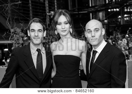 BERLIN, GERMANY - FEBRUARY 14: Fernando Eimbcke, Olga Kurylenko and Joshua Oppenheimer. Closing Ceremony of the 65th Berlinale International Film Festival on February 14, 2015 in Berlin, Germany